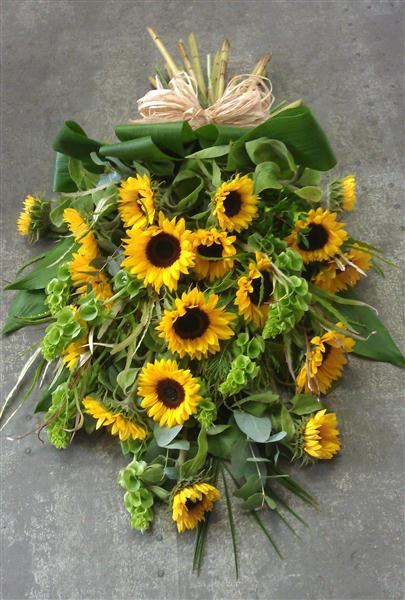 Sunflower tied sheaf funeral tributes by rays florist